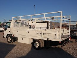 Material Hauling Flatbed Truck with a welder